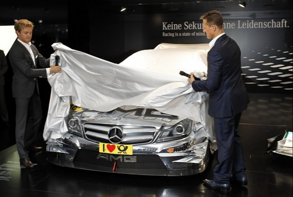 schumacher unveils 2012 dtm amg mercedes c coupe in frankfurt photo gallery medium 8 597x402 2012 DTM Car Unveiled By Schumacher And Rosberg