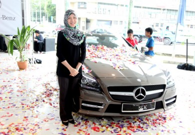 The winner poses with her new MB