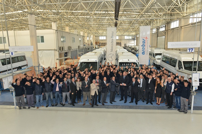 Arobus employees celebrate the 11,111th minibus modeled on the Mercedes-Benz Sprinter.