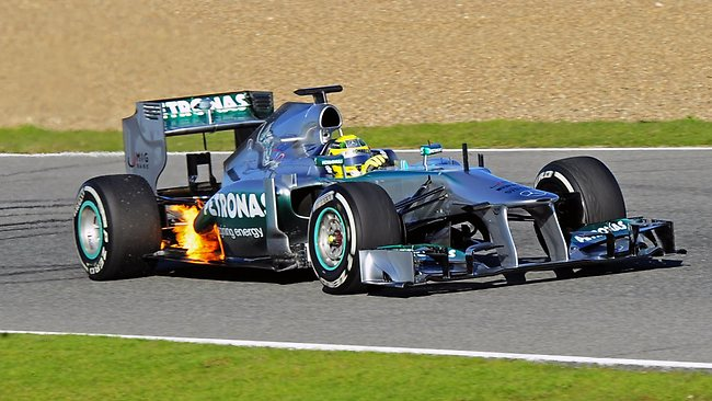 Flames are very visible around the rear end of the car driven by Rosberg.