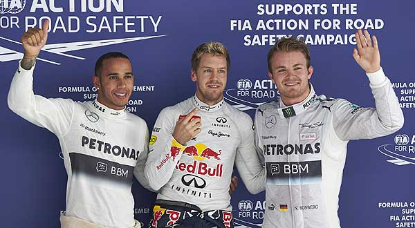 Mercedes F1 drivers Nico Rosberg and Lewis Hamilton with F1 champion Sebastian Vettel Rosberg Finishes Second in Indian Grand Prix