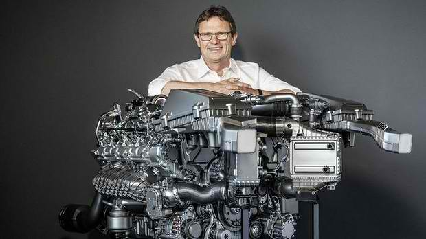 enderle poses with the new mercedes amg gt engine