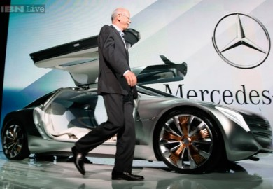 Dr. Dieter Zetsche walks towards the F125 Mercedes-Benz concept car during its unveiling at the 2011 Frankfurt Auto Show.
