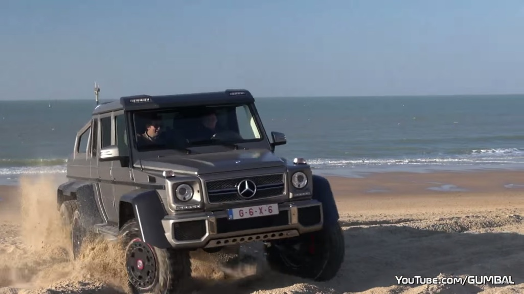 watch a mercedes benz g63 amg 6x6 perform drifting maneuvers at the beach a. Black Bedroom Furniture Sets. Home Design Ideas