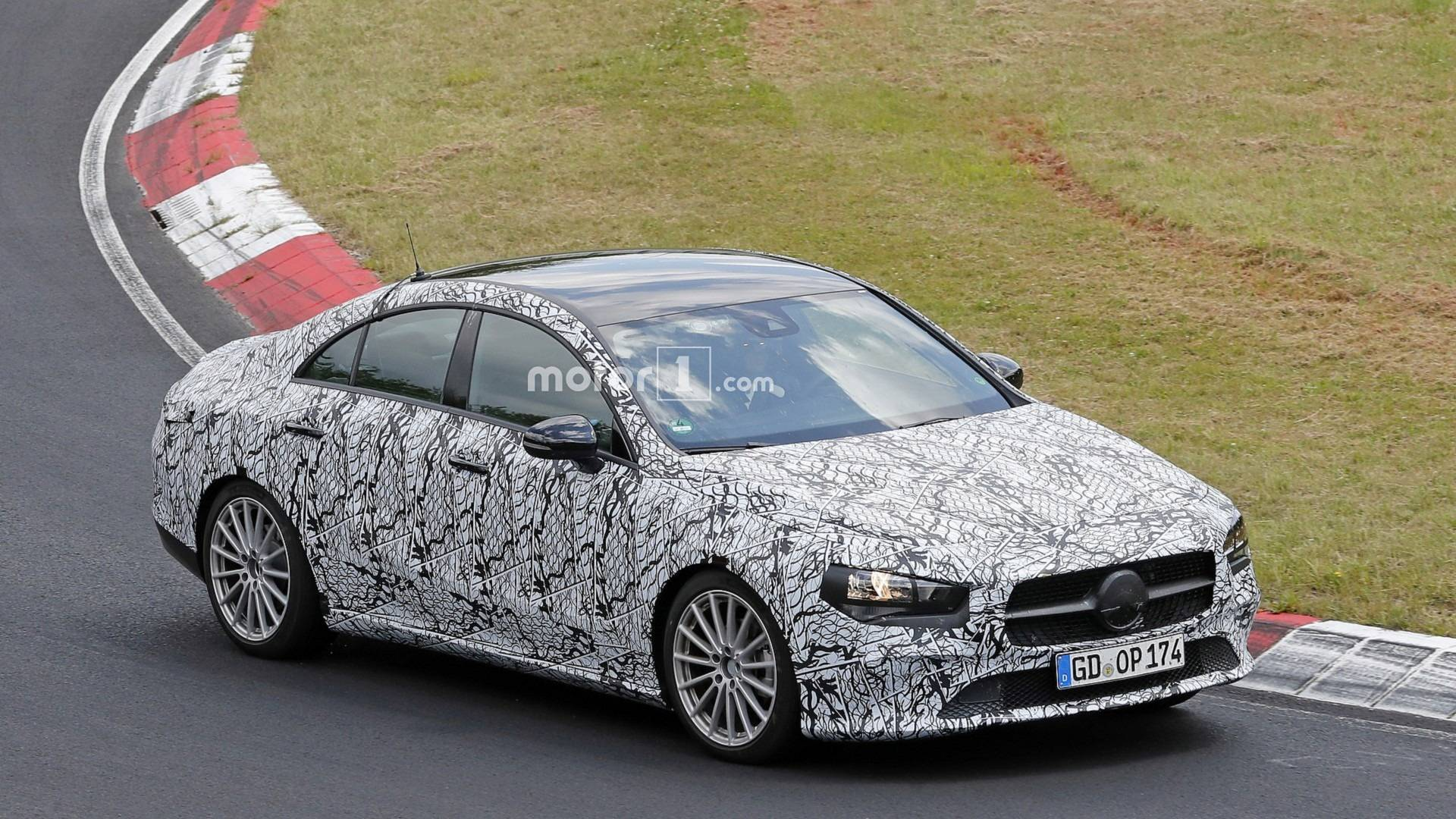 Here are the new spy shots of the next generation mercedes for Mercedes benz new model